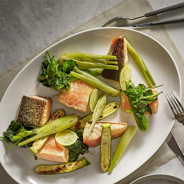 Salmon fillet steak served with baby fennel and courgettes